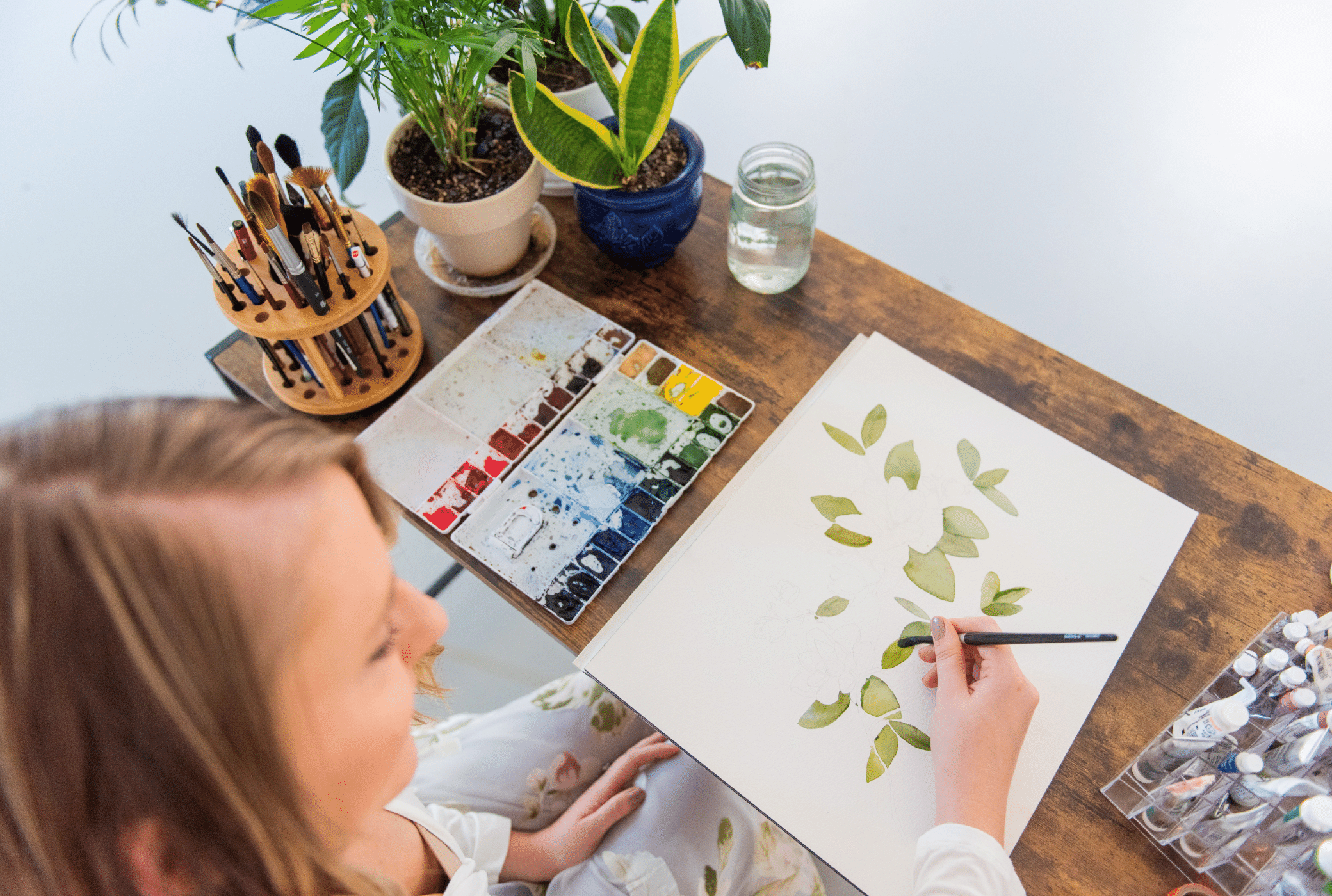 watercolor artist working on custom artwork
