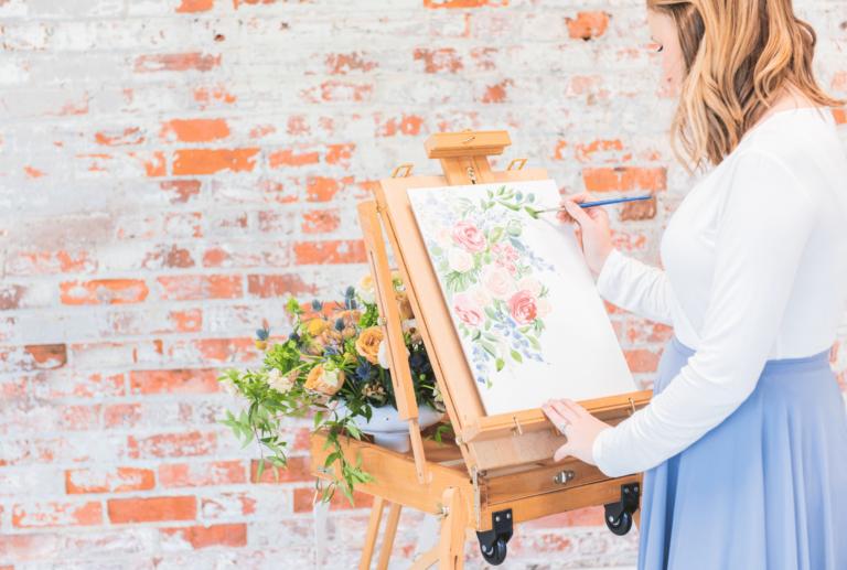 watercolor artist at work in studio