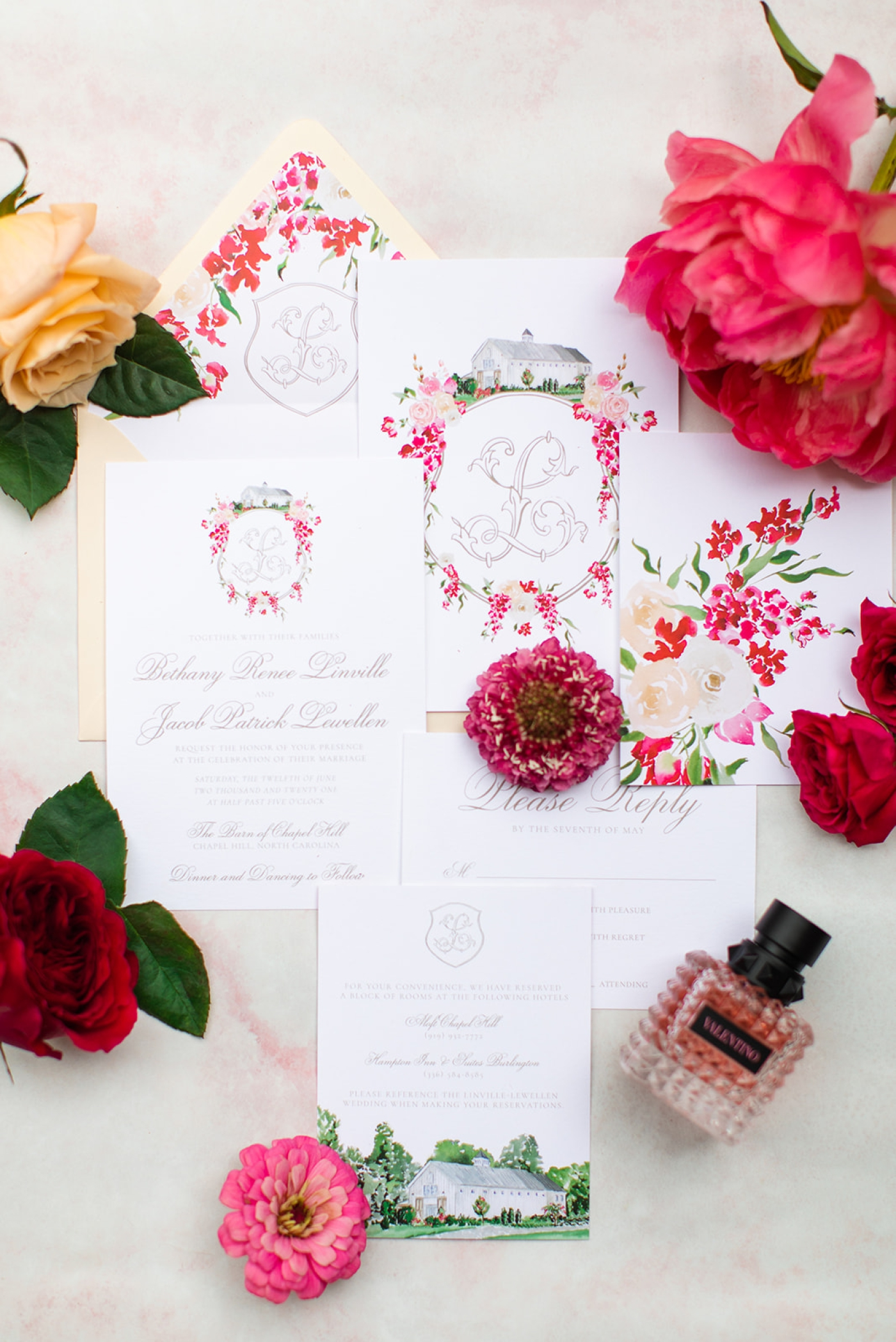 Red and blush watercolor floral crest for wedding invitations